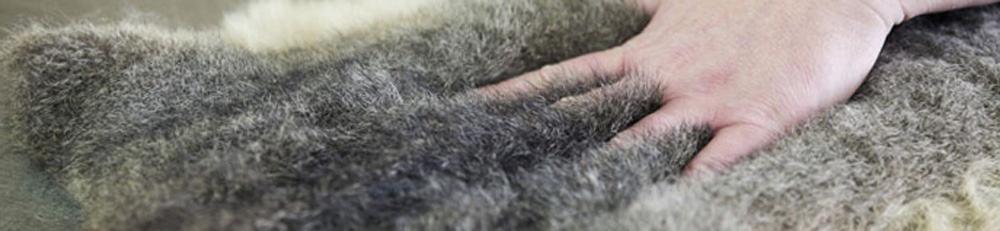 hand touching a possum fur product